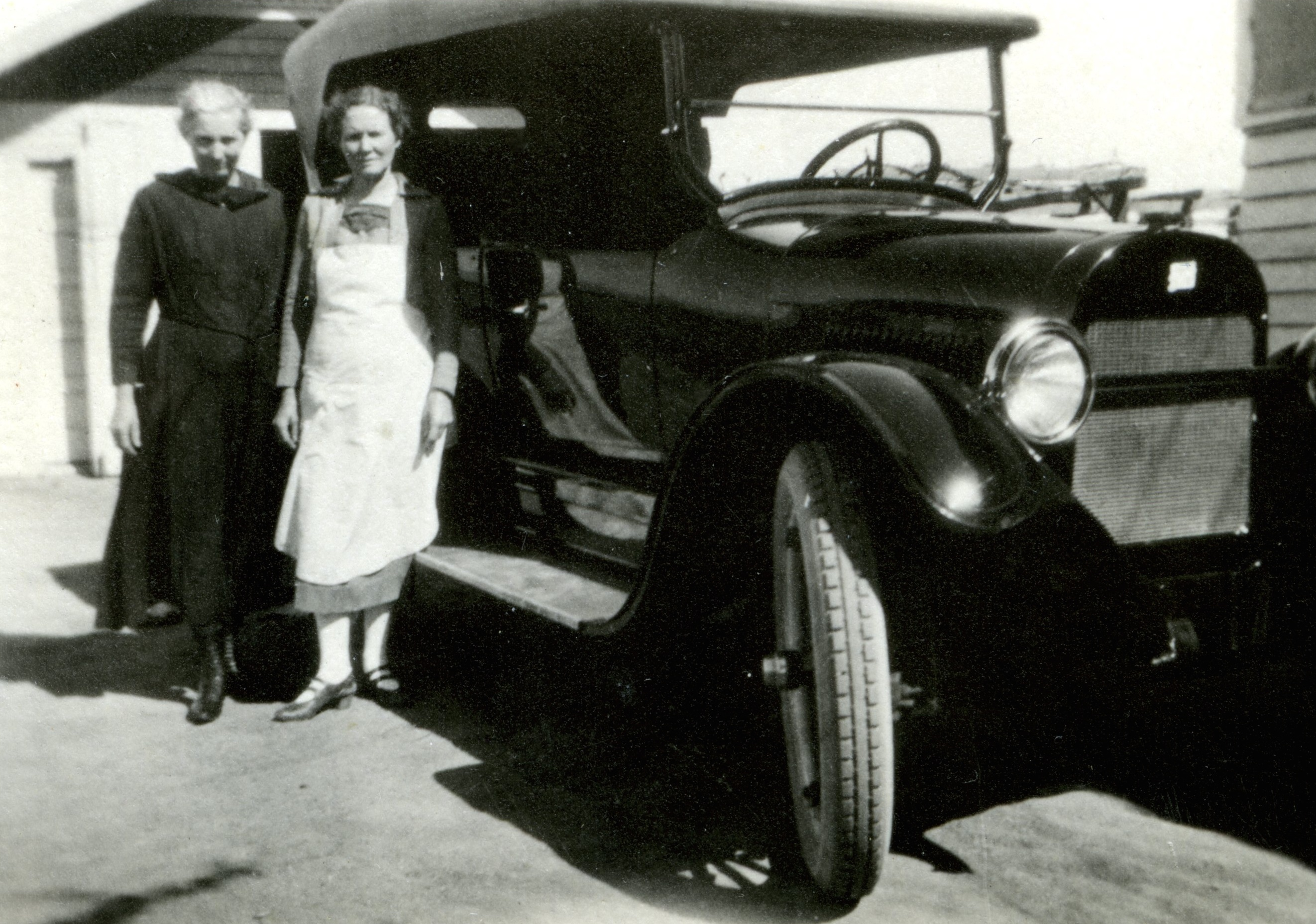 Aunt Em and Aunt Laura Orchard with Uncle Ote's Buick